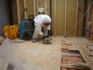 Water Damage Restoration Opening Floor Boards