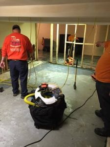 Technicians Making Renovations To A Home After A Flood