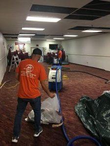 Technicians Repairing Leak Damage In An Office Space