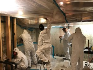 Technicians Conducting Flood Cleanup and Leak Repair Services